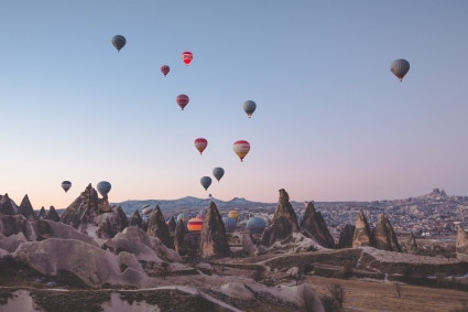 Balloons take flight.