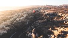Long balloon flys through the canyon.