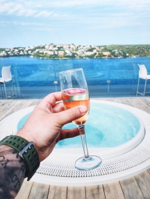 Cheers on there roof top with jacuzzi's