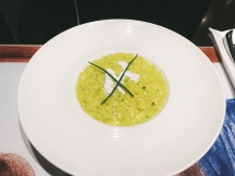 Risotto. with zucchini flowers, Apulian Burrata cheese, saffron and lemon confit .