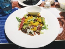 Fillet of Scottona Beef Carpaccio with nectarines, asparagus, arugula and seed mustard sauce.